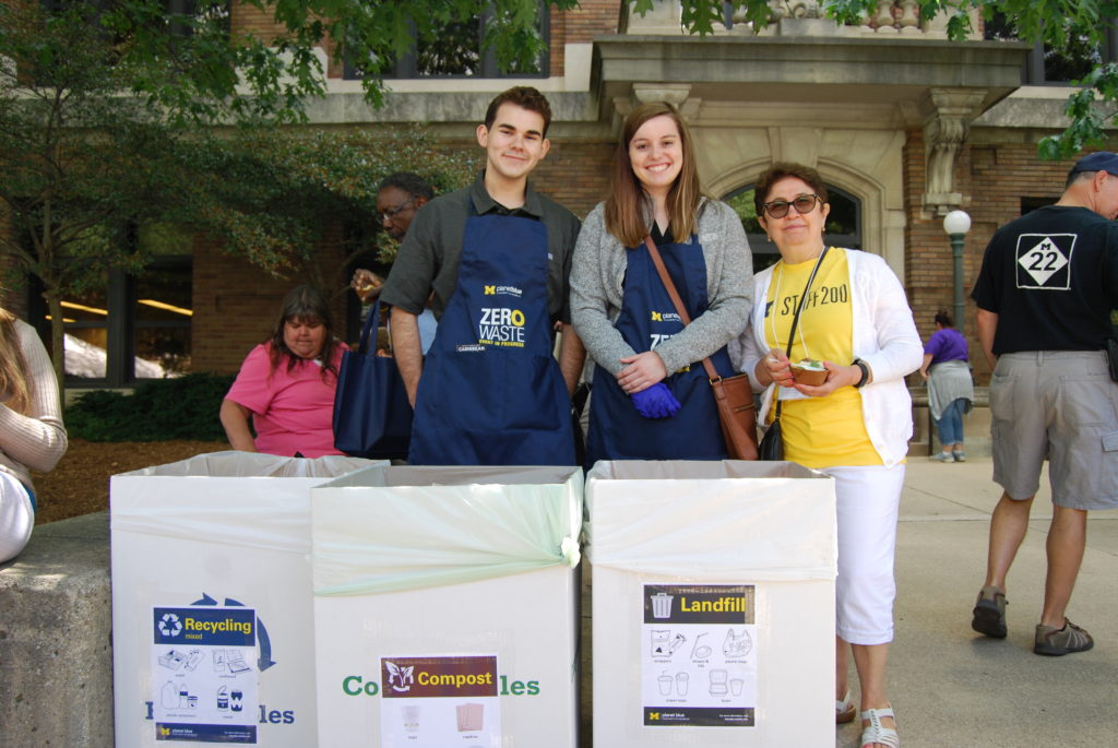 Zero waste volunteers with recycling and compost bins