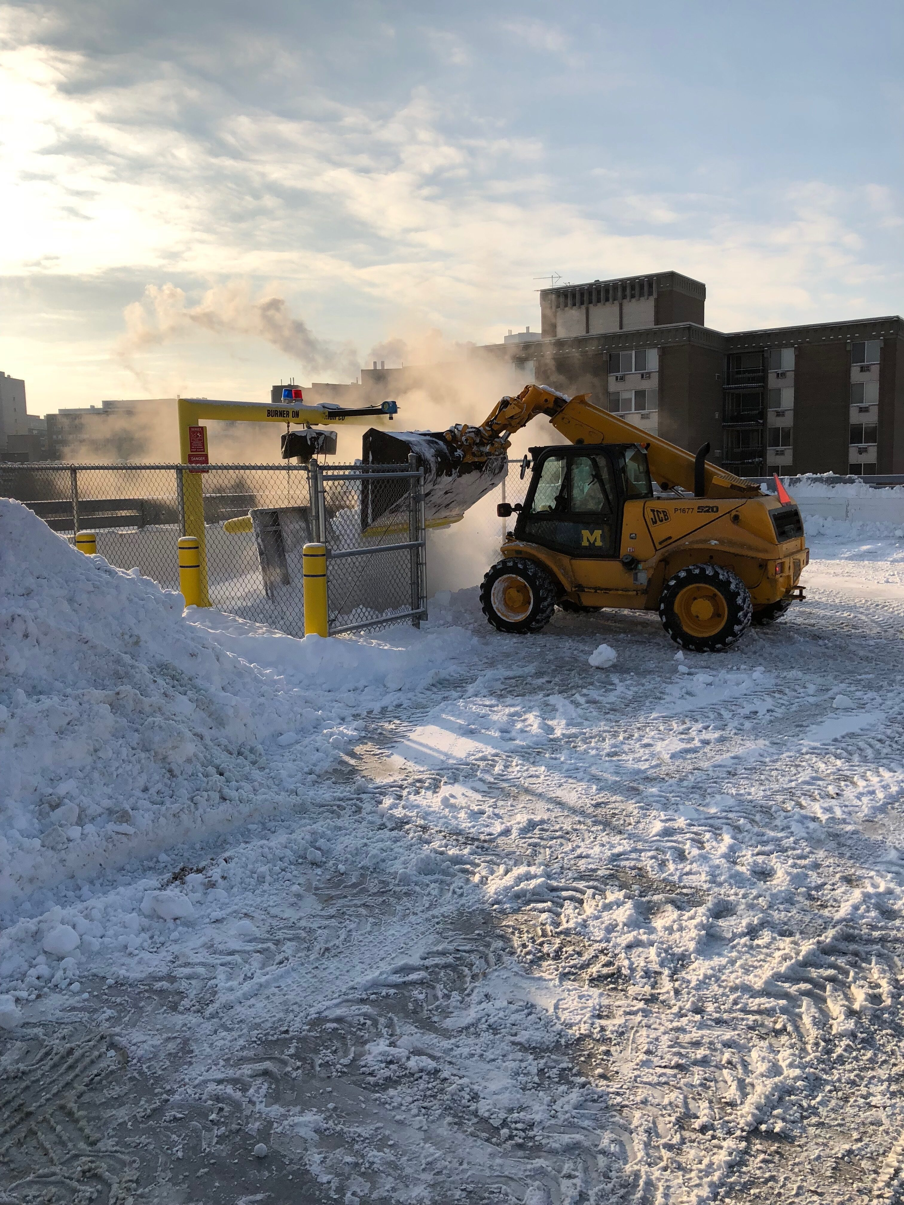 LTP staff clear snow from the top of a parking structure